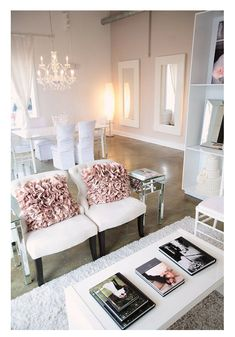 Love this space... clean but with a few ruffly details. I think my shabby chic chair + 1/2 & ottoman would fit just fine in the corner by the mirrors. (Pretty is a requirement, but no more than comfy!