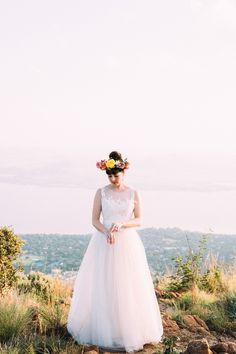 oversized floral crown, photo by Lad  Lass http://ruffledblog.com/villa-paradiso-wedding #bridal #weddingideas #brides