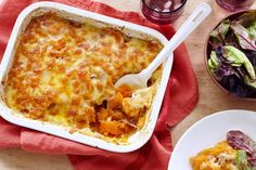This beautiful slow-cooked sweet potato bake, packed with cheesy layers, makes a fabulous vegetarian main or side dish.