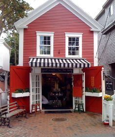 this shop would make a cute little house ~ love the red paint ~ Provincetown Shop by Becky Harris traditional exterior ~ from Holly Mathis Interiors Blog