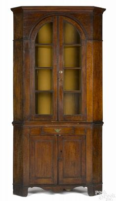 Pennsylvania curly maple two-part corner cupboard, ca. 1800, 83'' h., 40'' w. Provenance: Philadelphia Educational Institution.    Price Realized $2,400