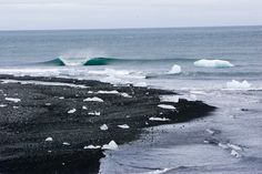 """No matter how high your froth factor, paddling out at perfect waves in some parts of the world is simply an exercise in masochism. """"Iceland is cold, heavy, and offers very small swell windows,"""" says Chris Burkard. """"Waves like this seem so inviting until you are standing on the beach, shivering in the freezing cold winds thinking about the even colder water temps."""" Photo: Burkard"""