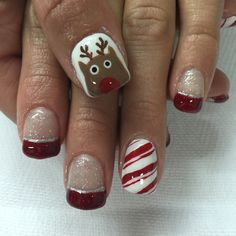 Sparkling Christmas red, candy cane and Rudolf gel nails. All done with non-toxic and odorless gel.