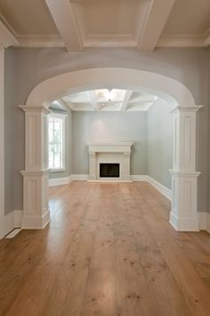 Natural Wood Floors, Tray Ceilings and Beautiful Trim Mouldings Incredible Interiors Traditional Living Room - via Houzz
