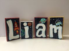 I painted these baby name blocks with a space theme...
