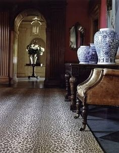 RALPH LAUREN....BLUE AND WHITE GINGER JARS, LEOPARD PRINTS AND DARK, MOODY WALLS....