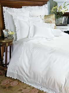 Amorosa - Fine Bed Linens - Like one-of-a-kind trousseau linens from your great grandmother's day, this exquisite import will be treasured for its lovingly hand-embroidered cut-work scrolls and scalloped edges