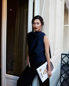 PFW ROUND UP Nicole Warne at Gary Pepper: black satin top and trousers, updo