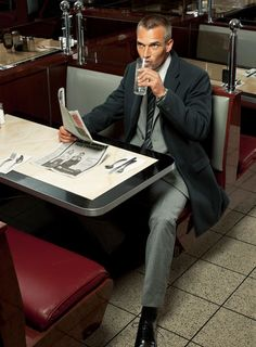 Real men eat alone in diners reading the paper.