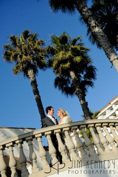 Bride and Groom on balcony at the Waterfront Beach Resort Hilton in Huntington Beach | Jim Kennedy Photographers