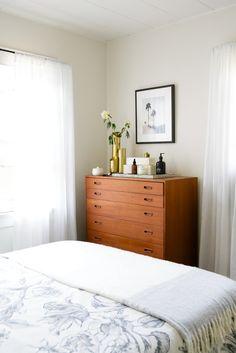 warm modern bedroom design with midcentury dresser via @citysage