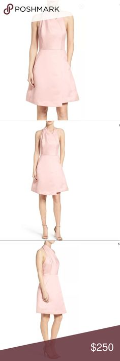 """HALSTON HERITAGE Draped Halter Satin Dress Size: 4 Color: Primrose (Pink)  Retail Price: $425 (SOLD OUT IN STORES!)  Measurements (measurements taken laying flat, side to side): Chest 15.5""""; Waist 14""""; Length 40""""  A draped halter neckline heightens the modern allure of this flared faux-wrap dress.  Back zip closure; buttons behind neck Halter neck Sleeveless Front pockets Lined 100% polyester Dry clean Halston Heritage Dresses"""