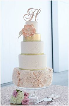 Classy blush and gold themed wedding cake!