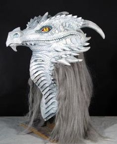 Ancient Dragon Mask White € Gorgeous and super realistic white Fantasy Dragon mask with silver grey synthetic hair on the back of the neck. Game of Thrones Gathering decor. Dragon Mask, Dragon Head, Dragon Halloween, Halloween Masks, Halloween Parties, Dragon Puppet, Dragons, Sculptures, Lion Sculpture