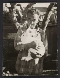 Citation: Man holding a rabbit, 194-? / Honoré Desmond Sharrer, photographer. Honoré Sharrer papers, Archives of American Art, Smithsonian Institution.