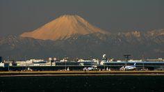 Fine weather in winter. Behind Haneda International airport in Tokyo, Japan, Mt. Fuji shows its solemn shape.