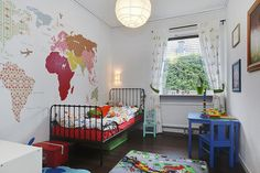 45 Vibrant and Lovely Kids Bedroom Designs -- map wall with feminine wallpaper prints