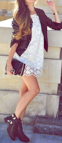 White lace mini dress with leather black jacket and golden shone black clutch and shoes