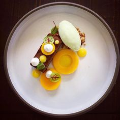 [chocolate] by @chefrichardkarlsson ・・・ Chocolate • Mango • Green apple • Lemon • Meringue. Plate by @studiomattes