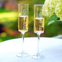 Personalized Contemporary Champagne Flutes. Mr. and Mrs. Smith flutes aren't these cute.