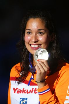 Gold medal winner Ranomi Kromowidjojo of the Netherlands celebrates on the podium after the Swimming Women's Freestyle 50m Final on day sixteen of the 15th FINA World Championships at Palau Sant Jordi  on August 4, 2013 in Barcelona, Spain.