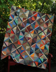 One of the first quilts to come off of my new Innova longarm quilting machine!  This is one of my favorite scrappy quilts, just perfect for...