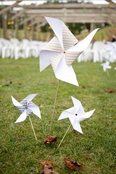 giant pinwheels staked in the ground = fun and silly and a little bit magical outdoor party decor