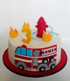 Vanilla cake with light and fluffy chocolate cream filling. All decorations are made out of fondant. Firefighter Birthday Cakes, Twin Birthday Cakes, Truck Birthday Cakes, Fireman Birthday, Dinosaur Birthday Cakes, Truck Cakes, Fire Engine Cake, Decors Pate A Sucre, Fire Fighter Cake