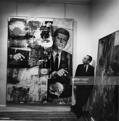 1964: The Italian contemporary art gallery manager Leo Castelli is sitting in his gallery looking at a picture by Robert Rauschenberg with the title 'Retroactive I'.