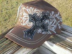 Brown  hat with blinged out cross.