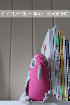 DIY Stuffed Animal Bookend - so adorable nestled up on the shelf!