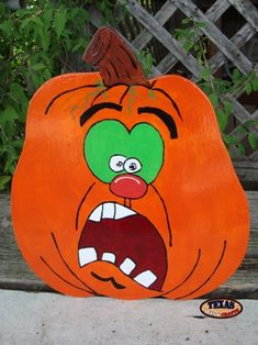 We make a variety of pumpkin arts and crafts. These arts and crafts items come in many different funny faces. Wooden Halloween Decorations, Halloween Yard Displays, Halloween Yard Art, Halloween Rocks, Halloween Boo, Halloween Pumpkins, Halloween Crafts, Pumpkin Face Paint, Pumpkin Art