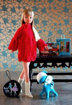 https://flic.kr/p/5Xju8x | Cricket in Petit Tricotage | Sometimes, a doll only needs a little care and the right dress to become a star. This Cricket, Tressy's sister, had a little restyle and a bubble bath. Afterward, she slipped into Petit Tricotage's bell sleeved hand knit red dress for Blythe and Twiggy's Courrèges boots. Her fancy deer friend is by Liz Cole for Retros. Barbie cases by Rebecca Brosdahl.