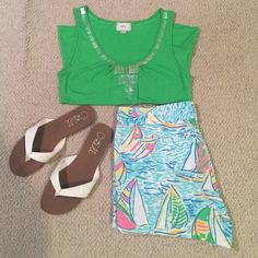 Green Embellished Tank Top Super soft green tank top with embellishments around the neck. It's in great condition! Tops Tank Tops