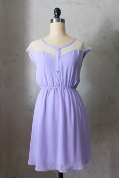 Le Petit Dejeuner Dress in Lavender. The perfect shade of light purple reminiscent of lavender fields in France. A lace inset in the bodice gives a delicate, sweet look and keeps things airy for spring and summer.