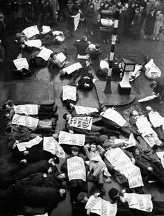 Unemployed men and women, campaigning for the provision of winter relief, bring the traffic on London's Oxford Street to a halt by lying down in the pouring rain.  January 17, 1939