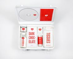 love hurts: first aid kit to survive any heartbreak. including: a mix cd, dark chocolate, vodka, bubble bath, a candle + matchsticks, heart-shaped candies, and, in case everything else fails to bring comfort, a pack of tissues. and lots of irony. | by melanie chernock