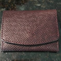 Auth Louis Vuitton jewelry holder Date code MI0064. Beautiful rich brown colored jewelry holder in excellent condition. Approximately 2.5 x 2 inches. Holds 2 rings as pictured and 1 pair of earrings in the pouch. Rings shown in photos NOT included. NO TRADES. No box or dust bag. Louis Vuitton Other