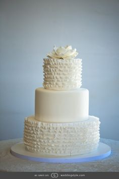 Fondant cake with handmade sugar paste ruffles and an edible magnolia. @grace_ormande @wedding_style