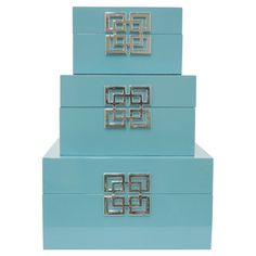 Stylishly stow photographs, trinkets, and accessories in these vibrant storage boxes, finished in light blue and showcasing a linked square accent.