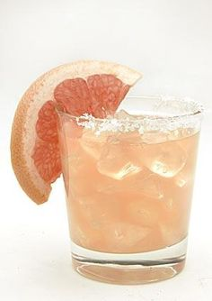Grapefruit Margarita  Servings: 4    Wedge of lime    2 teaspoons coarse margarita salt    1.75 cups ruby red grapefruit juice, with pulp (about 3 medium grapefruits)  2 tbspn  lime juice  1/2 cup reposado tequila  4 tbspn triple sec  4 slices grapefruit or twists