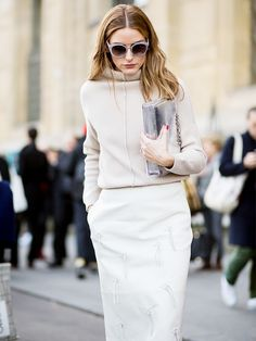 Olivia Palermo in a monochrome ensemble with a metallic clutch