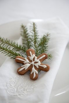 Linen napkin with Christmas cookie and evergreen sprig