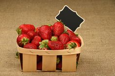 Fresh ripe summer red strawberry in rustic wooden crate basket with black chalkboard sign over canvas Basket Berry Fruit Blackboard  Canvas Chalk Chalkboard Close-up Crate Food Freshness Fruit Healthy Healthy Eating Natural Organic Price Tag Red Rustic Season  Sign Strawberry Studio Shot Summer Table Wooden