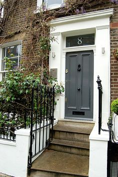glossy dark grey door, red brick, big white trim, black accents If you go with white, def different colored door. I like the dark grey :) DOOR COLOR Grey Front Doors, Painted Front Doors, Front Door Colors, Front Entry, Farrow And Ball Front Door Colours, Brown Brick Houses, Red Bricks, Up House, House Front