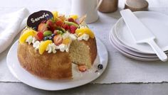 Not just another teatime sponge, this citrus-flavoured yeasted cake is soaked in orange liqueur syrup and crowned with Chantilly cream and fresh fruit. For when you want to go all out.   For this recipe you will need a 23cm/9in bundt tin or savarin mould, a sugar thermometer and a piping bag fitted with a star nozzle.