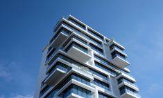 #appartment building #appartments #architecture #balconies #blue sky #building #condo #condominium #homes #real estate