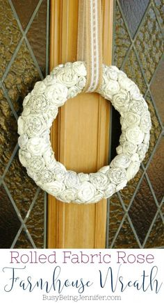 I love the neutral colors, the contrast in fabric patterns and the overall texture of this rolled fabric rose farmhouse wreath!