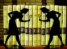 I really like the Nancy Drew bookends. This website also has a mystery party printable kit and party favors.