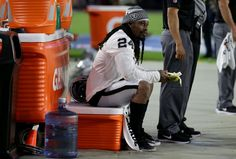 Raiders running back Marshawn Lynch sits during the national anthem.